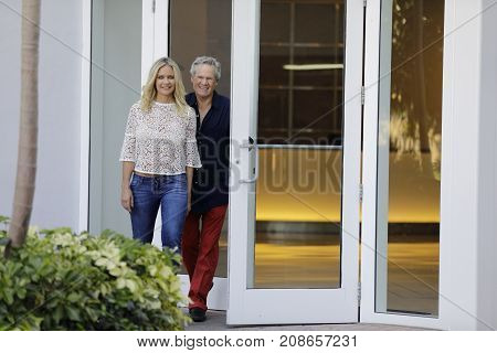 Couple Walking Out Of A Building