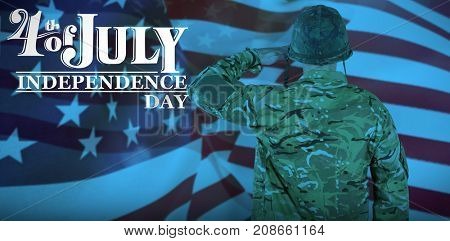 Rear view of military soldier saluting against focus on usa flag