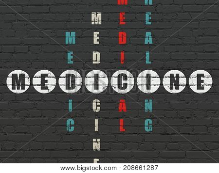 Medicine concept: Painted white word Medicine in solving Crossword Puzzle