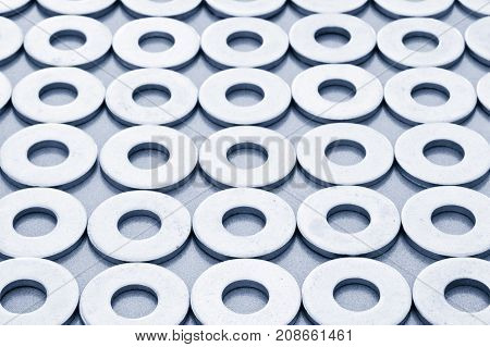 Closeup view of mechanical washers in rows.