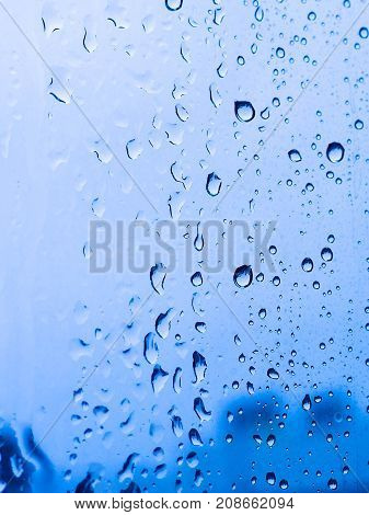 Rain Drops Or Water Drops At The Window.rain Drooping On Window Surface With Blurred Background Of T