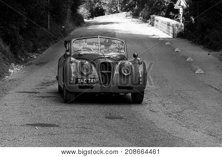 GOLA DEL FURLO, ITALY - JAGUAR XK 140 SE DROP HEAD COUPÉ 1955 on an old racing car in rally Mille Miglia 2017 the famous italian historical race (1927-1957) on May 19 2017