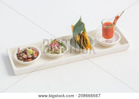Mexican style tapas snack. Nachos, ceviche, shrimp cocktail