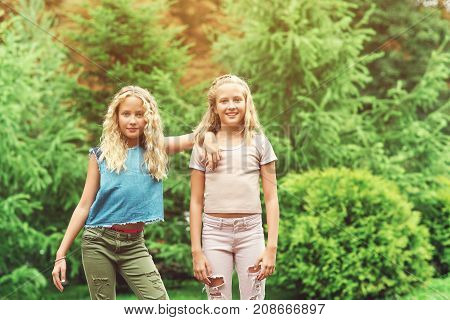 Portrait Of Beautiful Teenager Girls Twins At Park.