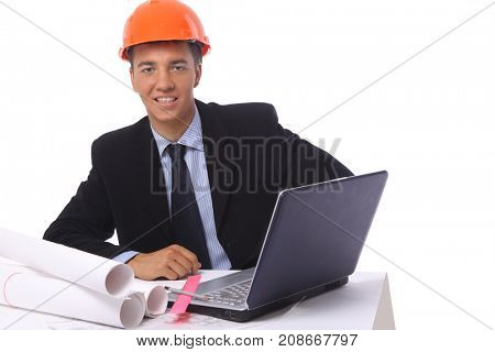 Portrait of positive male architect working at the laptop