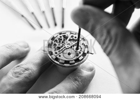 Process of installing a part on a mechanical watch watch repair