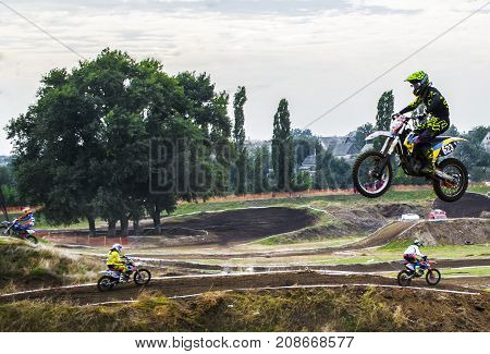 Extreme Sport Motocross. The Athlete Takes Off On A Motorcycle On A Springboard. Competition In City