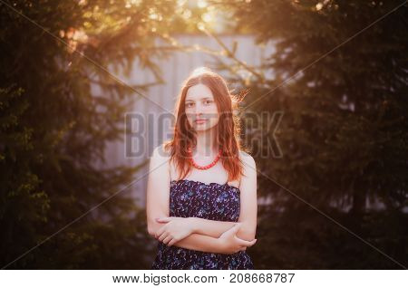 Portrait of a beautiful attractive young brunette girl alone outdoors.