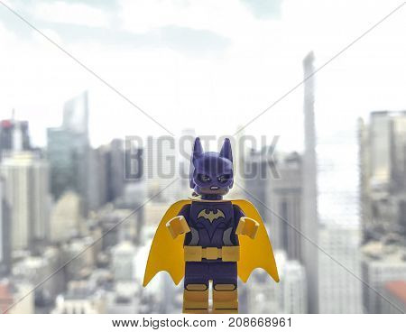 Batgirl Lego figurine high above New York City - Batgirl is a DC Comic character