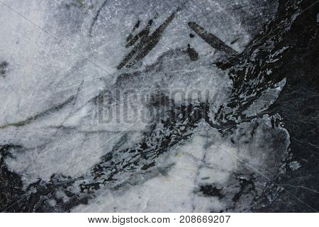 close up on drak blue and white marble wall background