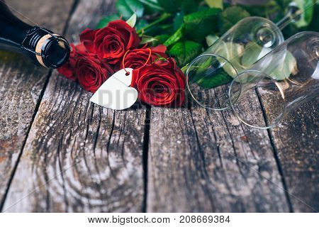 Bouquet Of Red Roses, Two Glasses, Bottle Of Wine, Gift Box With Tag On Vintage Wooden Board. Valent