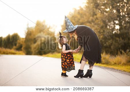 Little Witch And Her Mother Outdoors, Trick Or Treat