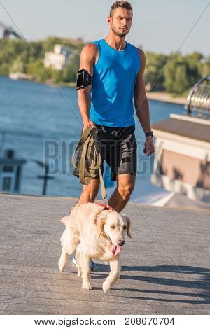 Sportsman Walking With Dog