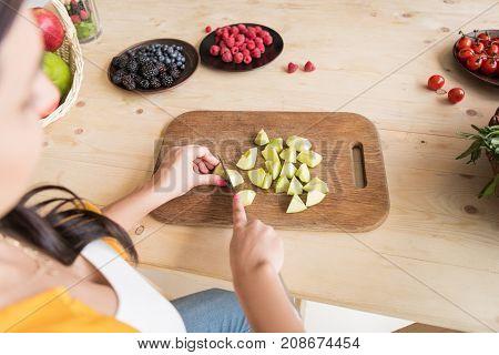 Woman Cutting Apple