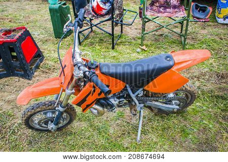 Extreme sports children's motorcycle children's motocross. Motorcycle of orange color