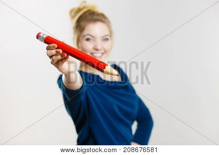Happy Woman Holding Giving Big Pencil