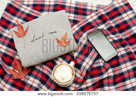Gray Sweater With The Inscription, Plaid, Smart Phone, Cappuccino Mug And Autumn Leaves. Fashionable
