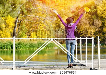 Girl In Hat Standing On The Dock. Autumn, Sunny. Back View