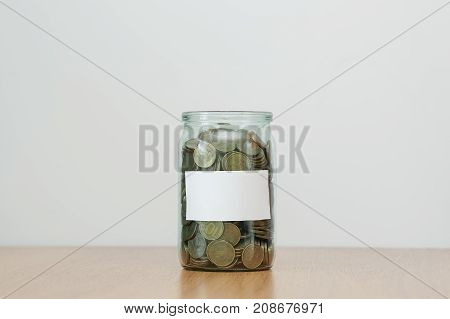 Hand putting money coin in to the glass jar. Future investment good profit