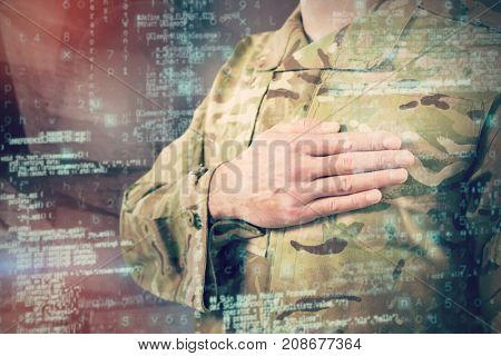 Mid section of soldier in uniform taking oath against abstract room