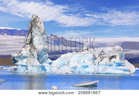 Stunning view of floating icebergs in the glacial lake Jokulsarlon at sunset Iceland