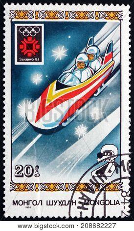 MONGOLIA - CIRCA 1984: a stamp printed in Mongolia shows Bobsledding 1984 Winter Olympics Sarajevo circa 1984