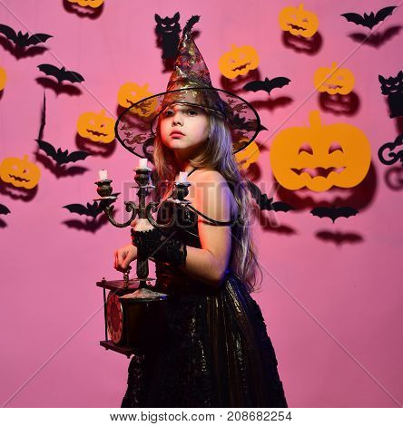 Halloween Party And Decorations Concept. Little Witch Wearing Black Hat