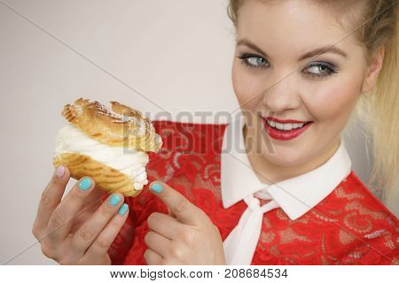Smiling Woman Holds Cream Puff Cake