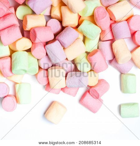 Colorful mini marshmallows isolated on white background macro. Fluffy marshmallows texture and pattern. High Resolution image