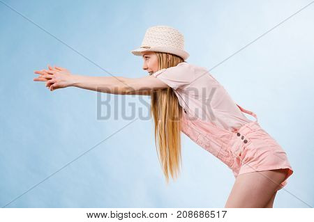 Woman Wearing Summer Outfit Pointing
