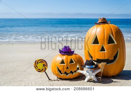Ocean Happy Halloween background with pumpkins with candy and starfish