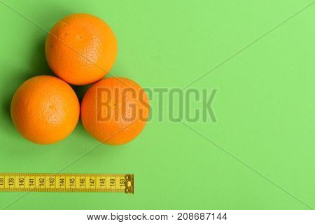 Pattern Made Of Oranges Near Tape Measure In Yellow Color