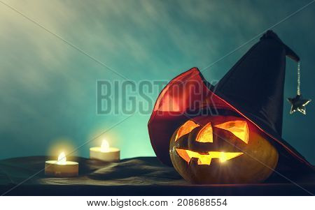 halloween pumpkin head with witch hat and candle light in darkness spooky background halloween background