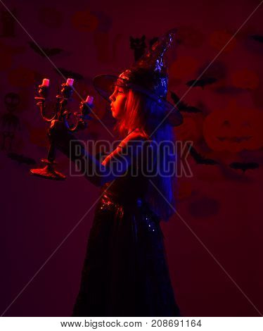 Little Witch With White Candles In Candlestick