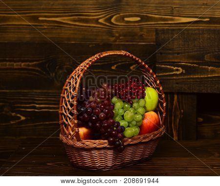 Basket Full Of Homegrown Autumn Fruit On Vintage Wooden Background