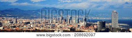 Barcelona Spain. Aerial view of Barcelona with sea and mountains at the background. Skyscrapers in Barcelona Spain