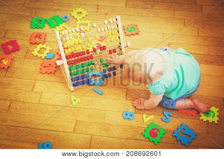 little girl playing with abacus, early child development