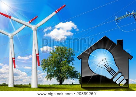 Model house with a light bulb wind turbines and a power line on a blue sky with clouds sun rays green grass and trees - Renewable energies concept