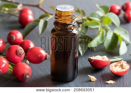 A Bottle Of Rose Hip Seed Oil On A Gray Background