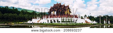 Chiang Mai Thailand. Royal Palace garden and temple cloudy sky reflected in the pond. Beautiful nature in a famous landmark in Chiang Mai Thailand