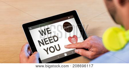 We Need You text with icons on screen against cropped image of man with digital tablet