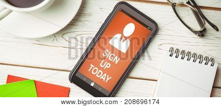 Vector image of Sign Up Now text with human icon  against overhead view of an desk