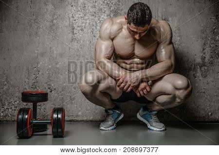 Model Man Bodybuilder Posing On Grey Background