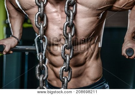 Brutal Bodybuilder Working Out In Gym With Chain.
