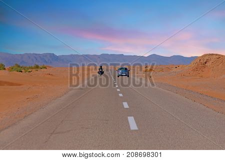 Driving through the Sahara Desert in Morocco Africa at sunset