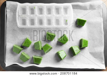 Tray with cubes of frozen vegetable puree