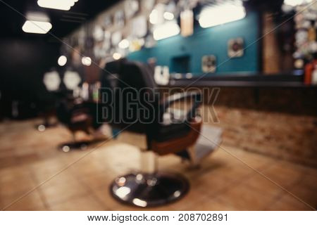 Blurred abstract background of modern hairdresser and hair salon, barber shop for men.