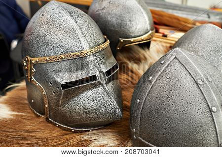 The helmets of medieval knights on furs