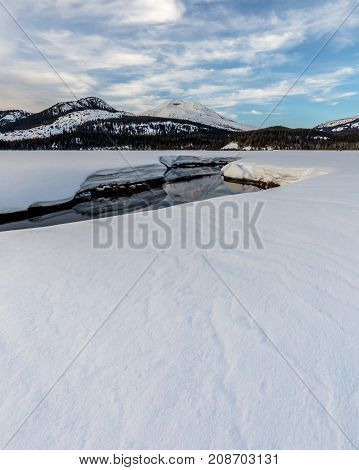 Snow on South Sister reflected in Soda Creek in the Deschutes National Forest Oregon.