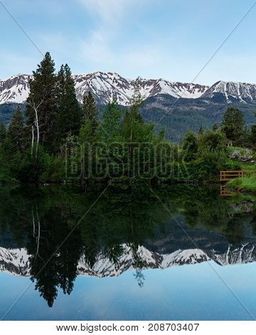 Wallowas in spring are reflected in a mountain pond, Oregon,